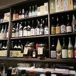 KushiyakiBar我が家 - ずらっと並ぶ焼酎の瓶