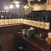 高山商店魚次 - ドリンク写真:サッポロ純良焼酎1升瓶のキープボトルが圧巻!!ホッピー割に♪