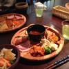 モクモク 風の葡萄 - 料理写真:ハム3種、ウインナー2種、魚のあらのスープ、サラダ、野菜胡麻和え、ブロッコリーとカリフラワーのナムル、みかんのマリネサラダ、かぼちゃとパプリカの甘酢あんかけ、緑茶
