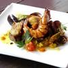タベラ - 料理写真:バレンシア風 パエリア ¥1,400 鶏肉と魚貝をたっぷり入れたミックスパエリア。 レモンを絞ってとさっぱりお召し上がりください。