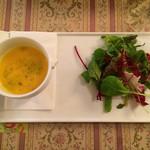 45206286 - かぼちゃのスープとサラダ