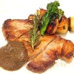 46438871 - ランチコース 3402円 のローズマリーでマリネした豚肩ロースのパリッと焼き トランペット茸(黒ラッパ茸)のソース