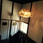 46695862 - 許可を頂き店内を撮影。階段とランプ。