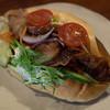 菓子とパン 大楠 - 料理写真:「照り焼きチキンとチーズ・ごぼうサラダ 野菜のサンドイッチ天然酵母パン」(450円)。