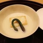 47761237 - 先付 焼き胡麻豆腐 白味噌仕立て