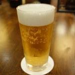 ラ・ベランダ - 1.000円のビールです。高いからと思って飲むとより旨いですね。(笑)