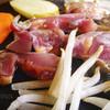 地鶏食堂 - 料理写真:溶岩プレートの焼き写真です。