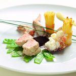 レストラン ひらまつ - 料理写真:ラングドック産仔牛ロースとリ・ド・ヴォー 香り立つオマールブルトン ローストしたじゃが芋のブーケを添えて