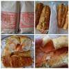 フルフル - 料理写真:◆明太フランスは2本購入しました(1本:380円:内税)・・半分に切り、その後切り目を入れて渡されます。 そのままよりも軽くトーストした方が、パンがカリッとして美味しい。