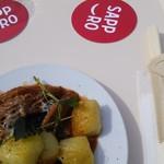 オステリア エスト エスト エスト. - 料理写真:北海道産牛トリッパのトマト煮込みと美深産北あかりの焼きニョッキ。