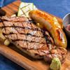 肉が旨いカフェ NICK STOCK - 料理写真:毎日20食限定★200g大ボリューム!サービスステーキランチ1000円+自家製ソーセージコンボ280円(+税)
