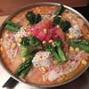 もつ鍋 亀八 - 料理写真:夏季限定のトマトもつ鍋は9月30日まで!1人前¥1580円(2人前~)