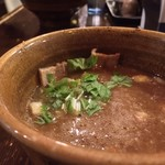56357597 - #食べログ的に撮るとこうなる。                         前回の辛つけ麺より食べやすいと感じた。                         これに卓上の唐辛子を少々加えたところ、好みの味わいに