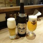 中華soba いそべ - 瓶ビール中瓶550円と 友人はプレミアムモルツ生450円