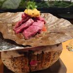 57758866 - 氷見牛とトマトと生ウニの朴葉焼き 1,500円