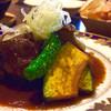 立ち呑みバル シルエラ - 料理写真:骨つき鶏もも肉の赤ワイン煮  480円