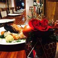 トラットリア ラ ロンディネ - クリスマスにかわいいお花のキャンドル