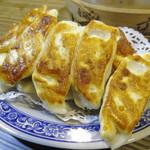 盛園絲瓜小籠湯包 - 「三鮮鍋貼」焼き餃子:160(TWD)=575円