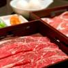 美山 - 料理写真:牛肉・豚肉食べ放題コース すき焼き風だしを選ぶと生たまご(おかわりOK)が付きます。