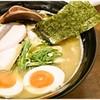 麺匠 黒庸介 - 料理写真:味玉入り濃厚黒鶏白湯らーめん 850円 思った以上にバシっとニンニクが効いてます!