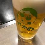 おかめ - マークが可愛らしい。ビール700円