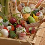 五條家 - 料理写真:毎月変わる創作串かつを1本100円~120円でご賞味ください。