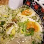 63126315 - スープに散りばめられている水菜が美しい