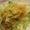 横浜榮吉 - 料理写真:お通し キャベツの千切りに榮吉オリジナル玉ねぎドレッシング