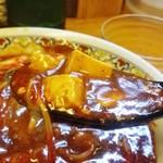 あかずきん - 麻婆豆腐と言うよりもカレースープに浮かんだ豆腐と言った味