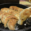 鉄なべ - 料理写真:博多名物の鉄板焼き餃子です。