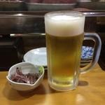 鈴女 - お通し + 生ビール(サッポロ黒ラベル <中ジョッキ> )