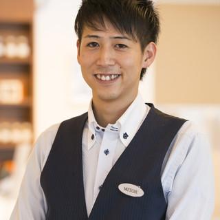 三藤義人店長