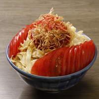 おかめ - 「トマトもんじゃ」。フレッシュなトマトが1個タップリと。