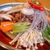 佳楽 - 料理写真:◎ 自 家 製 ヤンニョンで味付けした牛肉と  タップリ 野菜、春雨 などを専用 鉄板で 提供 いたします。
